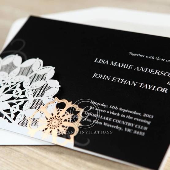White flat printing on black shimmer paper in a pocket style invitation featuring flower patterned laser cut design