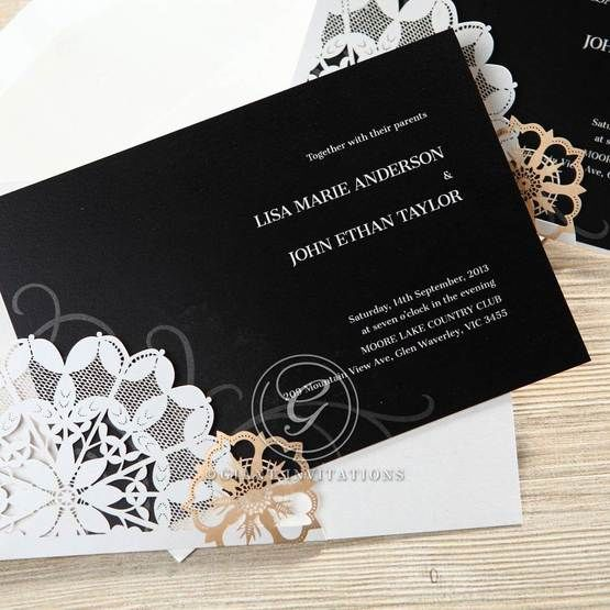 Slid out black inner paper in white pocket style invite with flower laser die cut designs