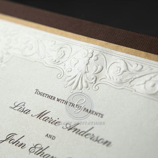 Embossed pearl paper on chocolate brown hard board, gold trim accent, zoomed in