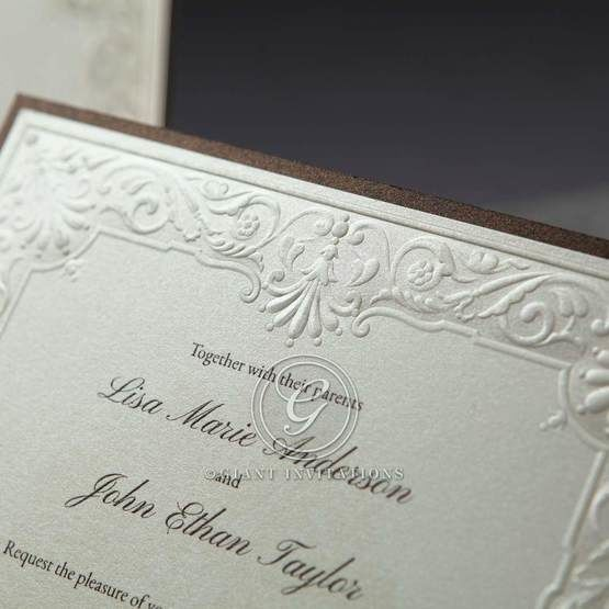 Zoomed in view of the embossed framing of the square layered type invitation, embossed