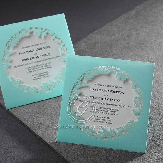 Blue pocket style wedding invitation with white matter paper, laser cut circular frame and thermography printing