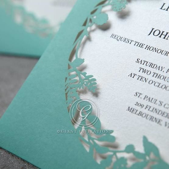 Cropped corner view of the tiffany blue laser cut pocket featuring nature inspired outlines
