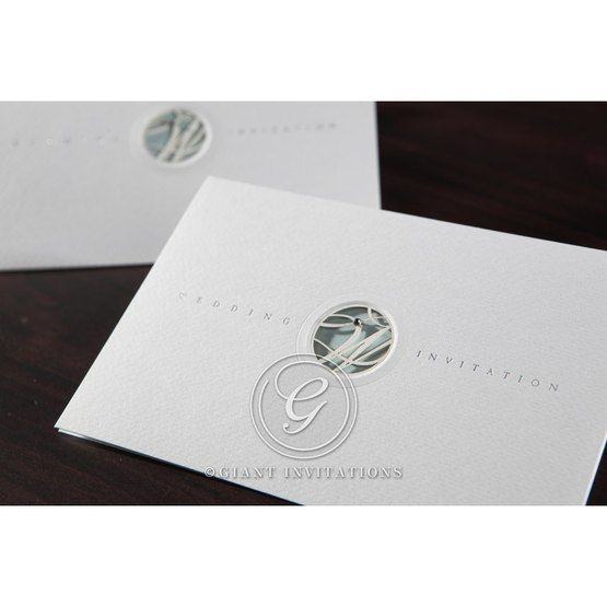 Cropped rectangular wedding invitation which opens like a letter, designed with a W monogram and diamante