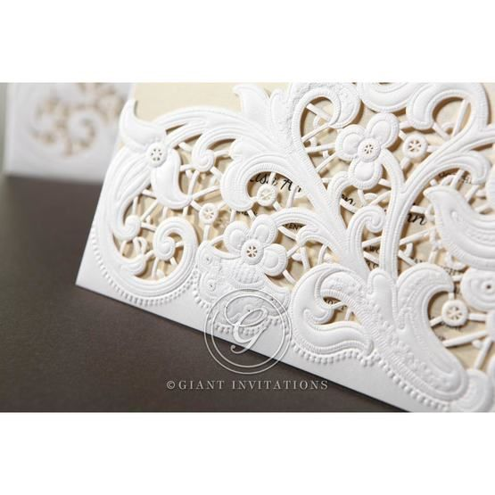 Cropped corner invitation with embossed swirl; matte pocket; laser cut