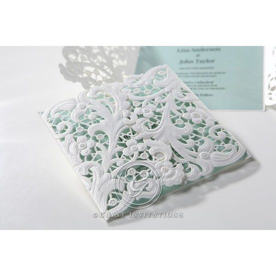 White laser cut swirl flap wedding invitation in white and blue