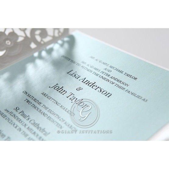 Cropped blue inner paper; gatefold laser cut invitation