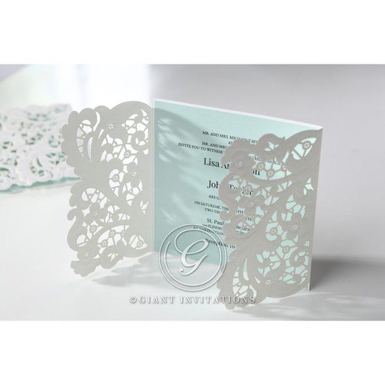 White laser cut invitation; floral; open flaps