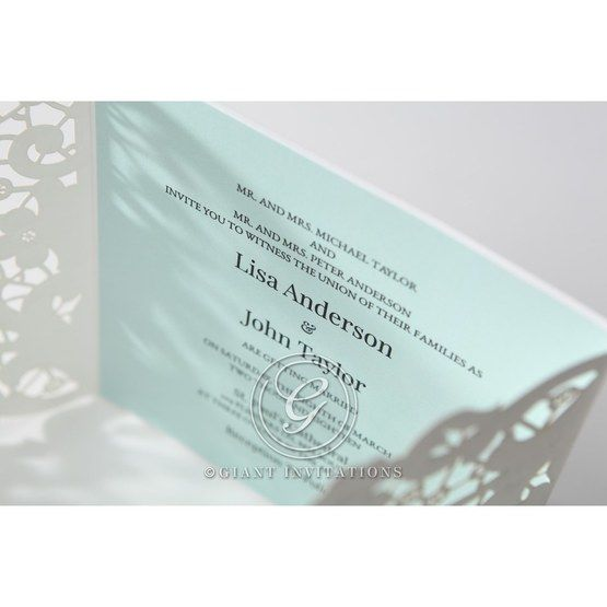 Laser cut floral invitation; white; blue inner paper; top view