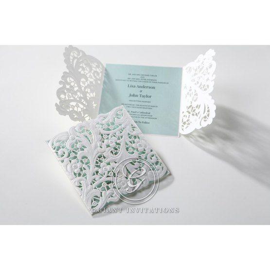 Laser cut floral invitation; white; blue inner card; open gatefold; closed gatefold