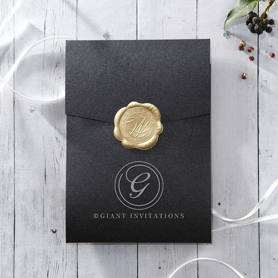 Black pocket invite on a pearlised card stock, sealed with a golden wax stamp with letter 'W' in the center