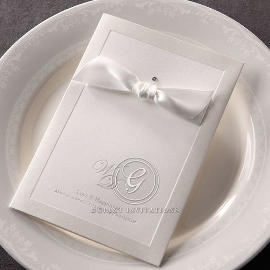 Folded wedding invitation with foil stammped cover with white ribbon,full view