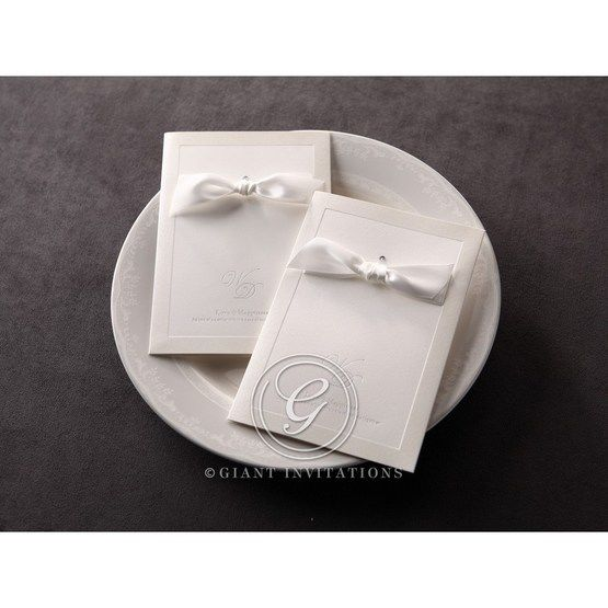 Jeweled, white ribboned invitation with hand assembled accent