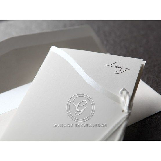 White invitation featuring silk screened pocket edge and side ribbon, monogram thermography