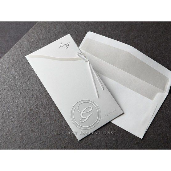 Fold type invite in full view with matching white invite featuring silver liner