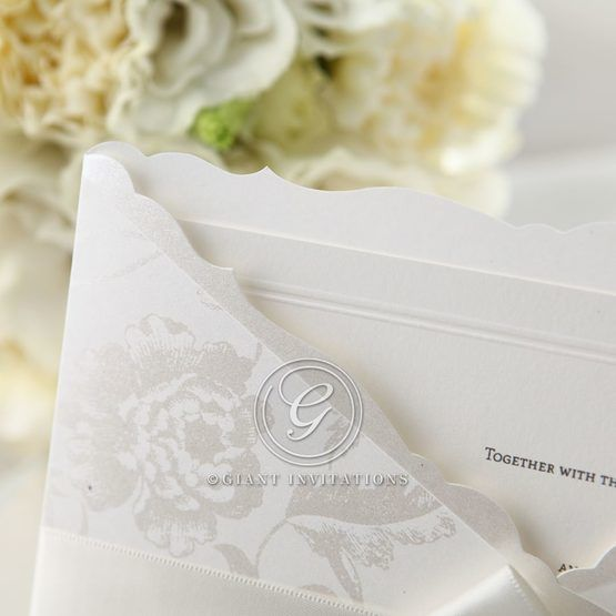 White floral pocket invitation with ribbon, cropped corner