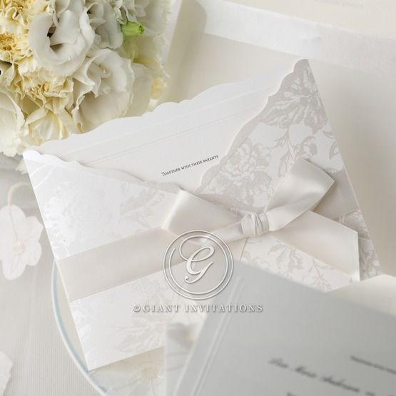 White pocket wedding invitations with white ribbon and flower design