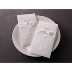 Two traditional embossed pocket invitation side by side showcasing white ribbon and intricate pattern embossing