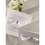 White invitations with silk finish paper and satin ribbon