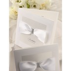 Pure white wedding invitations with ribbon and jewels