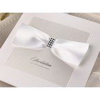White, square, folded wedding invitation with ribbon and jewels