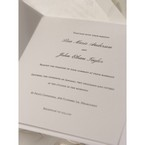 Black thermography in white inner paper, folded invitation