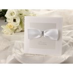 Classic white bordered wedding invitation with jeweled ribbon, cropped