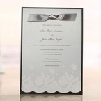 Layered type invite with black and gray combinatiom, ribboned, silkscreened finish insert, floral patterned