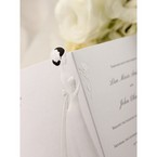 Embossed bride detail; opened wedding invite
