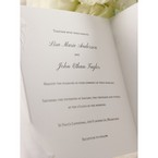 Raised printing on trifold black and white wedding invitation