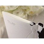 Black and white trifold wedding invitation; bride and groom embossed design; top view