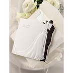 Black and white wedding invitation; bride and groom embossed design with envelopes