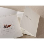 Semi folded wedding invitaiton in white, third panel partially folded featuring thermographic printed verse