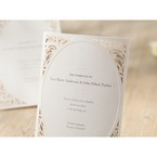 Cropped folded type wedding invite with oblong window and victorian swirl patterns in the corner