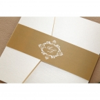 Golden belly band, with white coloured monogram, securing a slightly textured pocket invite