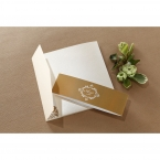 Lightly textured white card, with a dazzling golden belly band with monogram in white