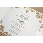 Pearlised inner card printed in raised ink font, with golden borders, set on a white pocket