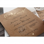 Black raised ink calligraphic writing on a brown craft paper, with shiny golden foiled text