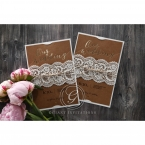 Brown craft insert card with pre-foiled text enclosed in a white lasercut sleeve adorned with twine