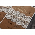Floral and lace patterned lasercut sleeve on a white pocket wrapped in twine, with a brown craft card in gold foil text