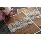 Intricate lace patterned lasercut sleeve adorned with a dainty twine, enclosing a brown craft card with gold foiled text