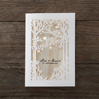 Wooden background on a forest theme invite with lasercut details, adorned with shimmering golden flowers
