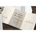 Black calligraphic fonts on a wooden theme trifold inner card with gold foiled flowers and white envelope