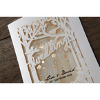 Forest theme lasercut cover with birds and trees on a white textured card, with wood theme inner card and golden flowers