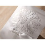 Pure white embossed traditional floral desgn , closeup