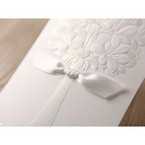 White ribboned embossed flower design wedding card