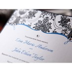 Zoomed in view of the swarovski crystal and trial coloured wedding invitation featuring digital ink of white, blue and black