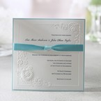 Embossed classic floral design flat layered invite with knotted ribbon and blue border