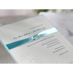 White invitation embellished with slim knotted ribbon feauturing raised ink lettering in black