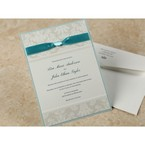 Raised textured lettering on pearlised card, ribbon embellished wedding invitation, blue backing layer