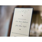 Black backing wedding announcement card with foil stamped designs
